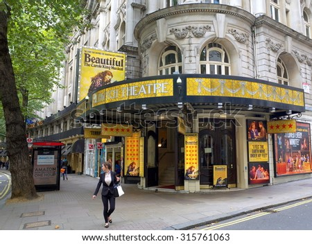 London, England - Sept 09, 2015: Pedestrian passing in front of the Aldwych Theatre entrance in London, England. Built in 1905 the theatre is currently playing Beautiful - The Carole King Musical - stock photo