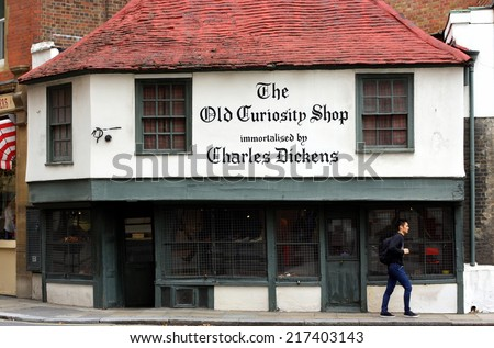 London, England - Sept 11, 2014: The Old Curiosity Shop in London is a 16th century building generally used for retail purposes. However, any connection with Charles Dickens is unproven. - stock photo