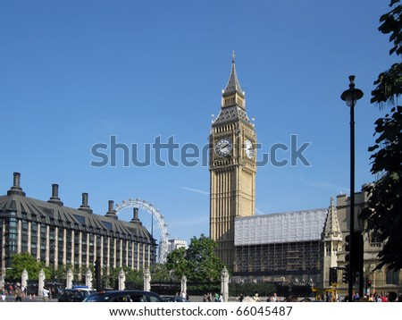 LONDON, ENGLAND - SEPTEMBER 25, 2009: Big Ben taken on September 25, 2009, with clear blue sky and with London Eye in the background. - stock photo