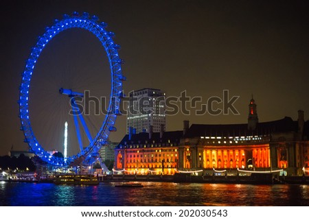 LONDON, ENGLAND - SEPTEMBER 26, 2013: The giant London Eye on the South Bank of the River Thames. Also known as the Millennium Wheel, it is the Europe's tallest Ferris wheel.  - stock photo