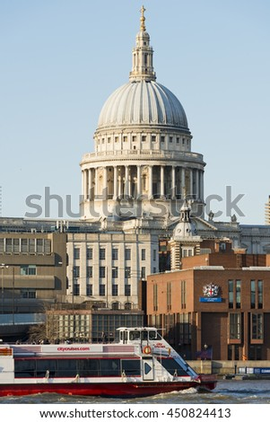 London, England, UK - April 02, 2013: A view of the dome of St Pauls's Cathedral from the South bank of the River Thames - stock photo