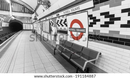 LONDON, ENGLAND UK - MAY 22, 2013: Russell Square is a London Underground station on Bernard Street, Bloomsbury in the London Borough of Camden. - Black & White with Red Underground sign - stock photo