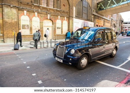 LONDON, ENGLAND / UNITED KINGDOM - MAY 18 2015 - London taxi through the city - stock photo