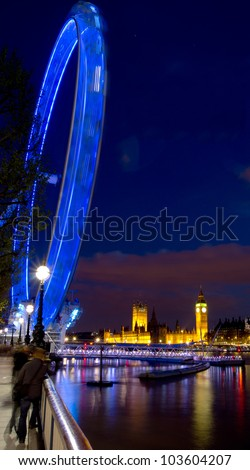 London Eye and Westminster over the Thames - stock photo