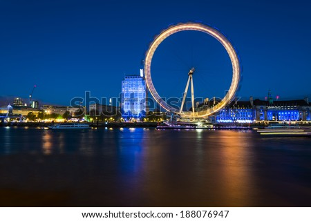 London Eye. London, United Kingdom - April 18, 2014: London, UK, skyline in the evening. London Eye is a famous tourist attraction at a height of 443 ft it is the biggest Ferris wheel in Europe. - stock photo