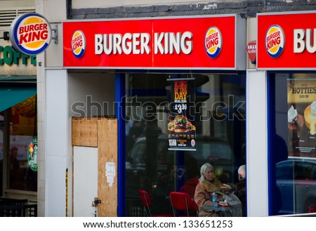 LONDON-FEB 17: Burger King Restaurant on Feb. 17, 2012 in London, United Kingdom. Burger King Worldwide Inc. is the second largest fast food hamburger chain in the world. - stock photo
