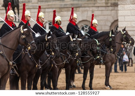 LONDON - FEB 16 : The royal horse guards during a training session pictured on February 16th, 2013, in London, England.  Founded August 1650, the regiment served in the French Revolutionary Wars. - stock photo