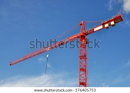 LONDON - FEBRUARY 9, 2016. A red building construction crane on a redevelopment site at Hammersmith, west London, UK. - stock photo