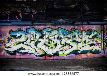 LONDON, GREAT BRITAIN - 13th of May 2014: Unknown graffiti artist painting on the Leake Street on 13th of May 2014 in LONDON, GREAT BRITAIN - stock photo