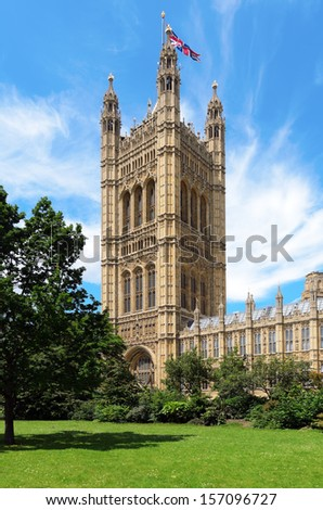 LONDON, GREATER LONDON, ENGLAND - JUNE 30: Victoria Tower and the Palace of Westminster on June 30, 2012 in London, Greater London, England.  - stock photo