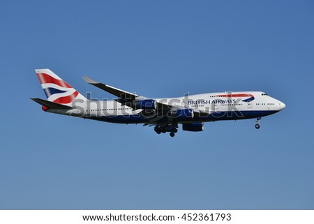 London Heathrow airport circa 2015; British Airways airplane Boeing 747 mid-air with wheels out prepared for landing at Heathrow airport   - stock photo