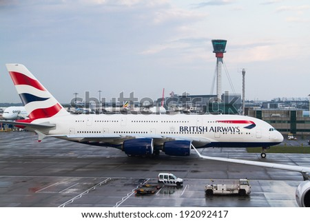 LONDON HEATHROW - APRIL 20: British Airways Airbus A380 taxis for take off on April 20, 2014 at London Heathrow Airport, London, UK - stock photo