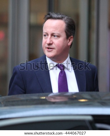LONDON - JAN  27, 2014: David Cameron, Prime Minister of the United Kingdom seen leaving 10 Downing street on Jan 27, 2014 in London - stock photo
