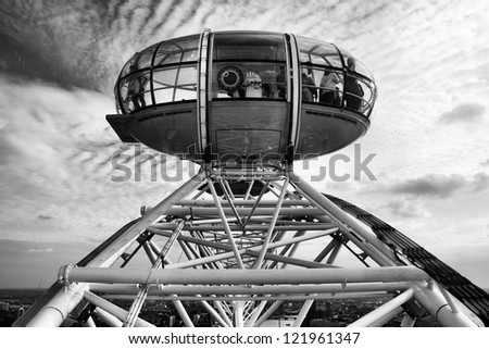 LONDON - JANUARY 26, 2012: A Participants of attraction London Eye in a cabin of a wheel of a review on January 26, 2012 in London, United Kingdom of Great Britain - stock photo