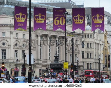 LONDON - JULY 8: Banners are flying above Piccadilly circus, London, to celebrate englands, Queen Elizabeth 60year reign, from 1953 to 2013. London, July 8, 2013. - stock photo