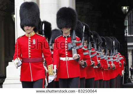 LONDON - JULY 14: Ceremonial Guard by Nijmegan Company of the Grenadier Guards preparing to greet the Malaysian Prime Minister Dato' Sri Najib Razak at Whitehall in Westminster, London, UK 14 July 2011. - stock photo