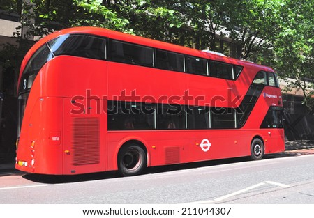 LONDON - JULY 12. London's Routemaster diesel-electric double deck bus with three doorways and two staircases, without applied advertising on July 12, 2014 in Tottenham Court Road, London, UK.  - stock photo