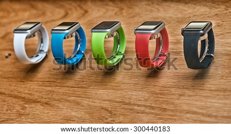 LONDON - JULY 2, 2015: Rows of new Apple Watch Sport sit at the retail store. Apple sold more than 3 million in the first months. - stock photo