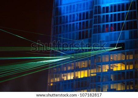 LONDON - JULY 5: The laser and light show to celebrate the inauguration of Europe's tallest building, The Shard, July 5th 2012 - stock photo