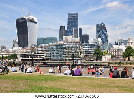 LONDON - JULY 16. The View from the south bank, across the River Thames with commercial skyscrapers dominating the Financial District skyline on July 16, 2014 in London, UK. - stock photo