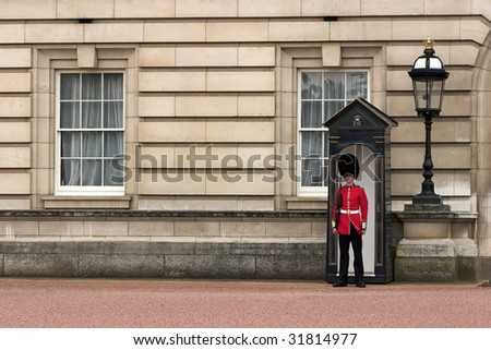 LONDON - JUNE 06: A Royal Guard at Buckingham Palace on 06 June 2009 in London, England. - stock photo