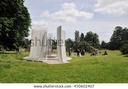 LONDON - JUNE 25, 2016. A Serpentine Gallery temporary summer house of vertical white fins designed by Asif Khan in Kensington Gardens, London, UK. - stock photo