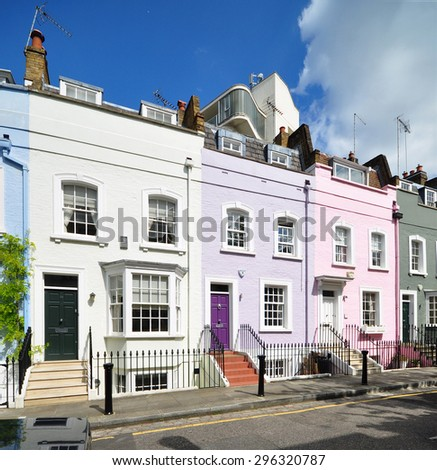 LONDON - JUNE 20, 2015.  A terrace of small eighteenth century Georgian period houses at Bywater Street in the Royal borough of Kensington & Chelsea, London, UK. - stock photo