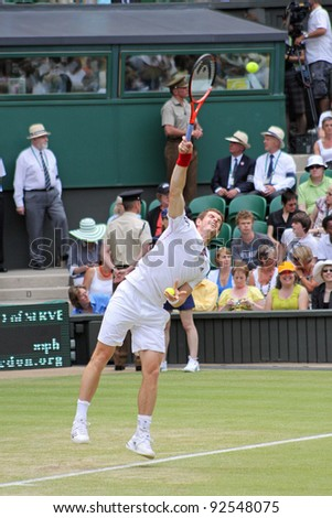 LONDON - JUNE 24: Andy Murray of Scotland serves ball during second round match against Jarkko Nieminen of Finland at Wimbledon in London, England on June 24, 2010 - stock photo