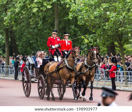 LONDON - JUNE 14:  Camilla Rosemary seat on the Coach at Queen's Birthday Parade, also known as Trooping the Colour, on June 14, 2014 in London, England. - stock photo