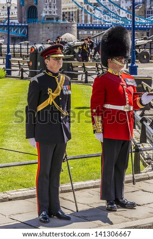 LONDON - JUNE 03: City of London's Territorial Army regiment perform a 62-round Royal Salute from Gun Wharf at Tower, to mark 60 Anniversary of Coronation of Queen Elizabeth on June 03, 2013 in London - stock photo