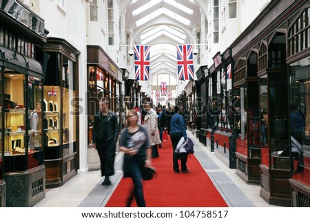 LONDON - JUNE 4: Inside view of Burlington Arcade, 19th century European shopping gallery, behind Bond Street, opened in 1819 for sale of jewellery and fancy articles on June 4, 2012, London, UK. - stock photo