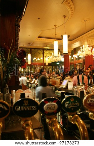 LONDON - JUNE 3: Interior of pub, for drinking and socializing, focal point of the community, on June 3, 2006, London, UK. Pub business, now about 53,500 pubs in the UK, has been declining every year - stock photo
