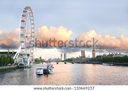 LONDON - JUNE 9 : London Eye, erected in 1999, is a giant 135m ferris wheel situated on the banks of the river Thames on June 9, 2012 in London, UK. It is the most popular attraction of the UK. - stock photo