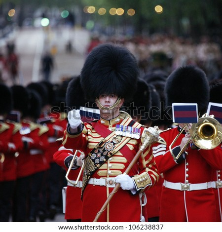 LONDON - JUNE 13: Massed Bands at Beating Retreat on June 13, 2012 in London, UK. Beating Retreat is a military ceremony, performed by military bands, takes place on Horse Guard Parade in White Hall. - stock photo