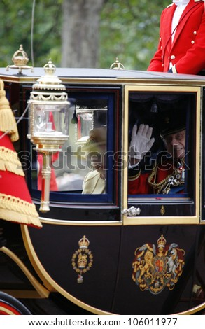 LONDON - JUNE 16: Queen Elizabeth II and Prince Philip seat on the Royal Coach at Queen's Birthday Parade on June 16, 2012 in London, UK. Queen's Birthday Parade take place in every June in London. - stock photo