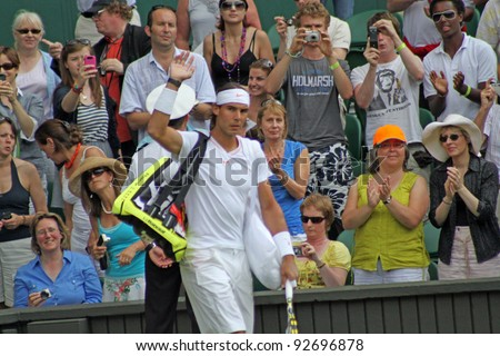 LONDON - JUNE 24: Rafael Nadal of Spain arrives for the second round match against Robin Haase of the Netherlands at Wimbledon in London, England on June 24, 2010 - stock photo