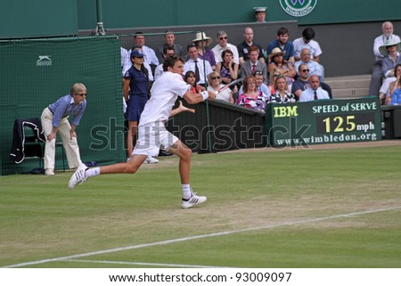 LONDON - JUNE 24: Robin Haase of the Netherlands returns ball during second round match against Rafael Nadal of Spain at Wimbledon in London, England on June 24, 2010 - stock photo