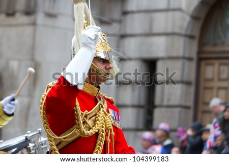LONDON - JUNE 5: The carriage procession makes its way to Buckingham Palace during Diamond Jubilee celebrations on June 5, 2012 in London. - stock photo