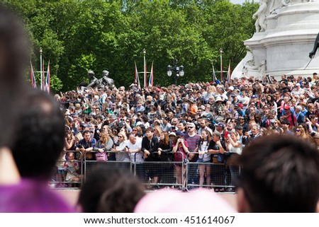 LONDON -JUNE 21, 2016: The colorful changing of the guard ceremony at Buckingham Palace  in London, UK. It is one of England's most popular visitor attractions. - stock photo