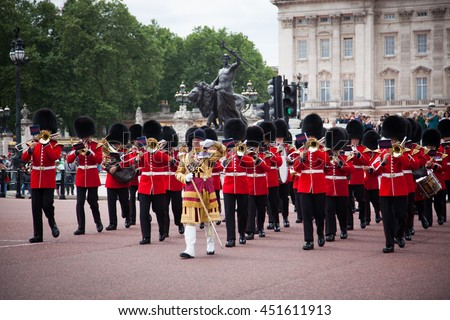 LONDON - JUNE 21, 2016: The colorful changing of the guard ceremony at Buckingham Palace on June 21 in London, UK. It is one of England's most popular visitor attractions. - stock photo