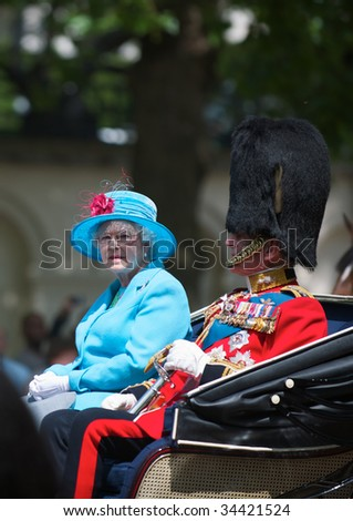 LONDON - JUNE 13: The Queen and The Duke of Edinburgh on The Queen's official birthday and is also known as the Birthday Parade, on June 13, 2009 in London, England. - stock photo