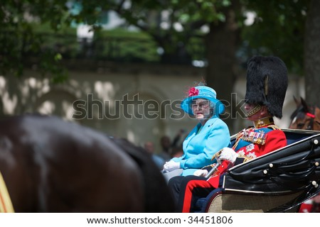 LONDON - JUNE 13: The Queen Elizabeth II and The Duke of Edinburgh on Horse Guards Parade, June 13, 2009 in London, England. - stock photo