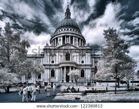 LONDON - JUNE 14: Tourist visits St Paul's Cathedral on June 14, 2012 in London, UK, founded in 604, completed in 1708, 111m high, locates at the top of Ludgate Hill, London. The infrared image. - stock photo