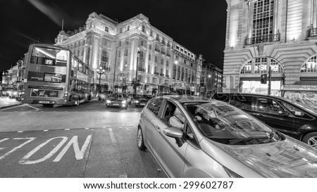 LONDON - JUNE 16, 2015: Traffic in Piccadilly Circus area. Piccadilly signs have become a major attraction of London. - stock photo