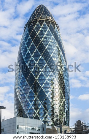 LONDON - JUNE 3: View of Gherkin building (30 St Mary Axe) at sunset in London on June 3, 2013. Gherkin - iconic symbol of London, one of city's most widely recognized examples of modern architecture. - stock photo