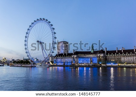 LONDON - JUNE 3: View of the London Eye at night, on June 3, 2013 in London, England. London Eye - a famous tourist attraction over river Thames in the capital city London. - stock photo
