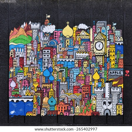 LONDON - MARCH 28, 2015. A mural painted on the Queen Elizabeth Hall, an entertainment venue built in 1967 and part of the Southbank Centre complex near the River Thames in London, UK. - stock photo