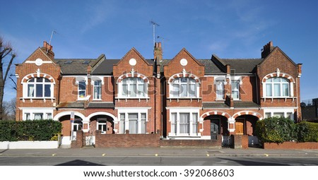 LONDON - MARCH 14, 2016. A terrace of old town houses located in the Fulham Palace Road in the Borough of Hammersmith & Fulham, west London, UK. - stock photo