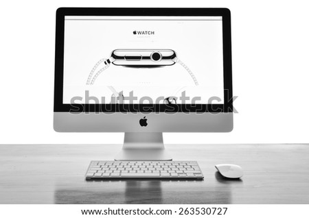 LONDON - MARCH 25: Apple iMac with the new iWatch displayed on the screen, image processed in black and white. March 25, 2015 in London, UK. - stock photo