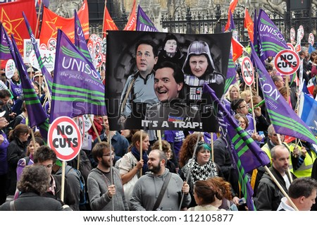 LONDON - MARCH 26: Austerity protesters march on Parliament in opposition to government spending cuts on March 26, 2011 in London, UK. An estimated 250,000 people took part in the TUC organised rally. - stock photo